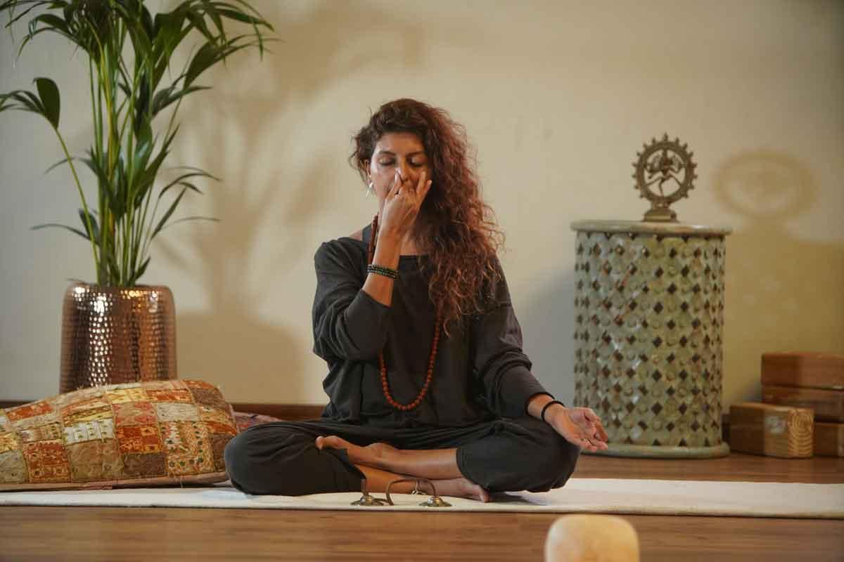 Nilaya House - bBack to School Special - Woman yoga breathing - pranayama
