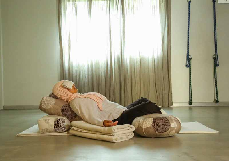 Nilaya House - BACK-TO-SCHOOL SPECIAL OFFER - Woman doing restorative yoga